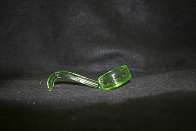 press glass spoon glued