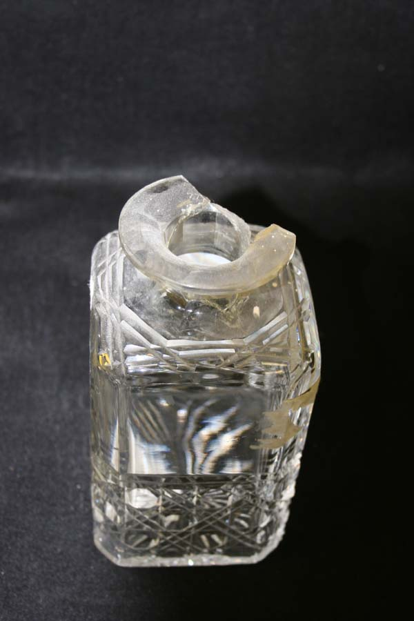 Crystal decanter with a broken neck  and missing pc.