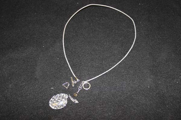 chipped and broken glass pendent