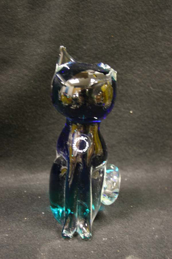 glass cat with one broken ear