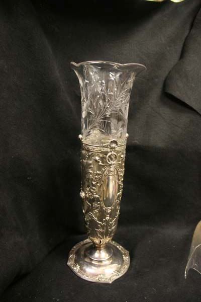 Repaired cut glass glass vase in silver foot