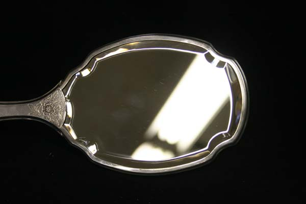 Antique beveled glass hand mirror
